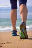 Woman's legs, runner's legs ocean beach. Royalty Free Stock Photography