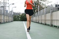 Woman`s legs running exercise outdoors. Fitness and wellness concept. Healthty woman`s legs running exercise outdoors. Fitness and wellness concept stock images