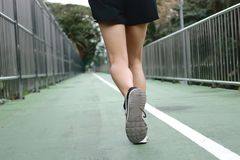 Woman`s legs running exercise outdoors. Fitness and wellness concept. Healthy woman`s legs running exercise outdoors. Fitness and wellness concept royalty free stock images