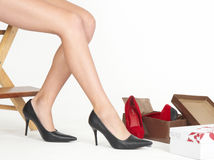 Woman's Legs Shoe Shopping in Shoe Store Royalty Free Stock Photo