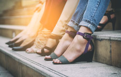 Woman`s legs in shoes rest on the step. Closeup woman`s legs in shoes rest on the step Royalty Free Stock Image