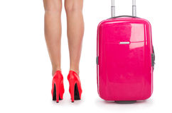 Woman's legs in  shoes and  suitcase Royalty Free Stock Images