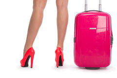 Woman's legs in shoes and  suitcase Royalty Free Stock Photos