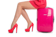 Woman's legs in shoes and  suitcase Stock Image