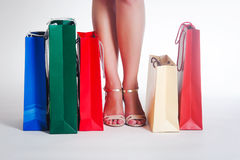 Woman's legs and shopping bags Stock Image