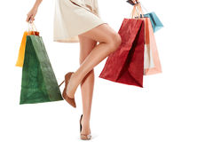 Woman's legs and Shopping Bags Isolated on White Stock Photo