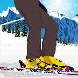 Woman's legs in ski boots with spray of snow Stock Image
