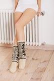 Woman's legs in socks Stock Image