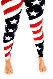 Woman's legs in stars and stripes leggings bare feet Royalty Free Stock Photo