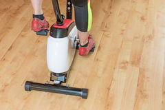 Woman`s legs training on the exercise bike closeup Stock Photography