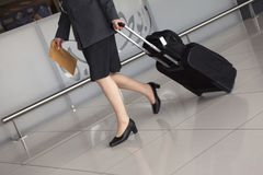 Woman's legs, travel suitcase Royalty Free Stock Photo