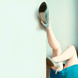 woman's legs up against a wall Stock Images