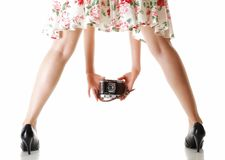 Woman's legs and vintage camera Royalty Free Stock Image