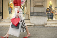 Woman's Legs Waling by Store Stock Photos