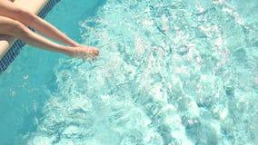 Woman`s legs in water. stock footage