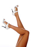 Woman's legs wearing heels Royalty Free Stock Images