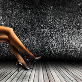 Woman's Legs Wearing Pantyhose and High Heels Stock Photo