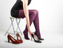 Woman& x27;s Legs Wearing Pantyhose and High Heels. With space for text Royalty Free Stock Images