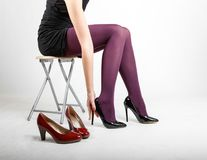 Woman& x27;s Legs Wearing Pantyhose and High Heels. With space for text Royalty Free Stock Photo