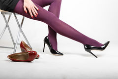 Woman& x27;s Legs Wearing Pantyhose and High Heels. With space for text Royalty Free Stock Photography