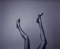 Woman's Legs Wearing Spandex Pantyhose and High Heels Royalty Free Stock Photography