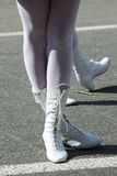 Woman`s legs in white boots. Attractive legs of young women in white boots standing on street royalty free stock photo