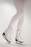 Woman's Legs in White Ice Skates Royalty Free Stock Images