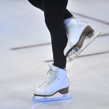 Woman's Legs in White Ice Skates Stock Images