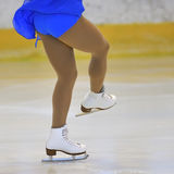 Woman's Legs in White Ice Skates Stock Image