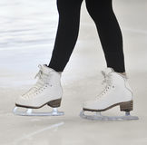 Woman's Legs in White Ice Skates Stock Photo