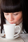 Woman's lips on cup of coffee Royalty Free Stock Photos