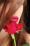 Woman's lips and red rose Stock Images