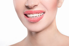 Woman's lips strewed with sugar Royalty Free Stock Photo