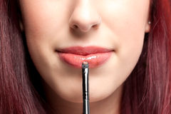 Womans Lipstick application Royalty Free Stock Image