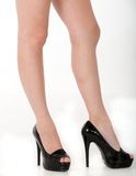 A woman's long legs, posing in high heels. Stock Photography