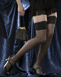 Woman's long legs in sexy black stocking. Stock Image