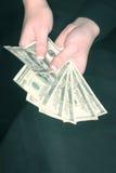 Woman's money stock images