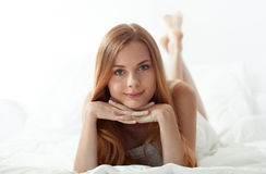 Woman's morning in bed Stock Photos