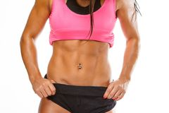 Woman`s muscular stomach. royalty free stock photography