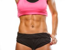 Woman`s muscular stomach. royalty free stock image