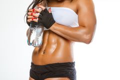 Woman`s muscular stomach. royalty free stock photo