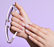 Woman's nails with beautiful french white manicure Royalty Free Stock Photography