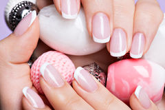 Woman's nails with beautiful french white manicure Royalty Free Stock Images