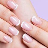 Woman's nails with beautiful french white manicure Stock Photo