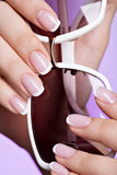Woman's nails with beautiful french white manicure Stock Photos