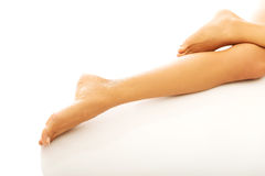 Woman's naked crossed legs lying Stock Photo