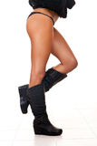 Woman's naked legs in boots royalty free stock photography
