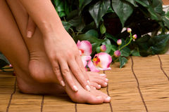 Woman's pedicure and manicure feet/hands Royalty Free Stock Images