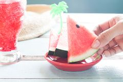 Woman`s picking piece of watermelon, Summer Healthy concept. Close up Stock Photo