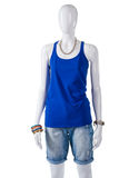 Woman's plain blue tank top. Blue tank top on mannequin. Summer outfit with blue top. Simple cotton garment on showcase Stock Photography